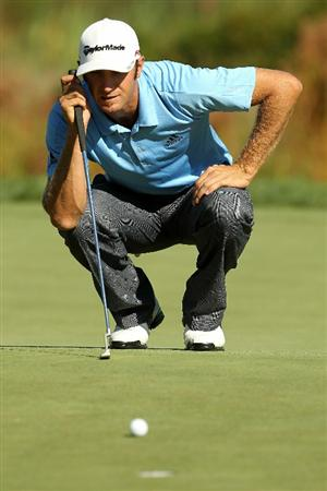 NORTON, MA - SEPTEMBER 04:  Dustin Johnson lines up a putt on the 16th green during the second round of the Deutsche Bank Championship at TPC Boston on September 4, 2010 in Norton, Massachusetts.  (Photo by Mike Ehrmann/Getty Images)