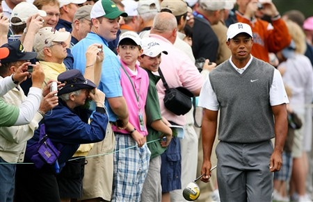 AUGUSTA, GA - APRIL 07:  Tiger Woods walks in front of some patrons during the first day of practice prior to the start of the 2008 Masters Tournament at Augusta National Golf Club on April 7, 2008 in Augusta, Georgia.  (Photo by Andrew Redington/Getty Images)