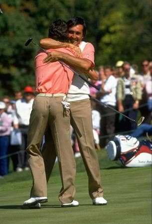 1987:  Seve Ballesteros and Jose Maria Olazabal of Spain hug each other at the 18th hole after their success during the Ryder Cup at Muirfield Village in Ohio, USA. Europe won the event with a score of 15-13. \ Mandatory Credit: Simon  Bruty/Allsport