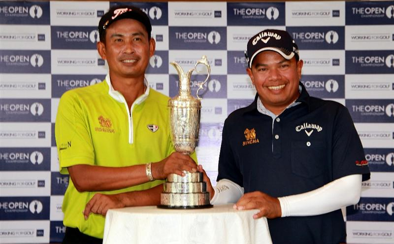 BANGKOK, THAILAND - FEBRUARY 23:   Thaworn Wiratchant and Prayad Marksaeng of Thailand pose for photographs during the press conference at the R&A Junior Coaching Clinic at Amata Spring Country Club on February 23, 2011 in Bangkok, Thailand.  (Photo by Stanley Chou/Getty Images)