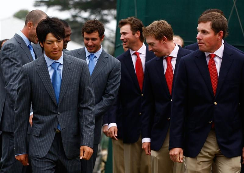 SAN FRANCISCO - OCTOBER 07:  Ryo Ishikawa of the International Team walks to the stage alongside Justin Leonard of the USA Team during the Opening Cermonies prior to the start of The Presidents Cup at Harding Park Golf Course on October 7, 2009 in San Francisco, California.  (Photo by Scott Halleran/Getty Images)