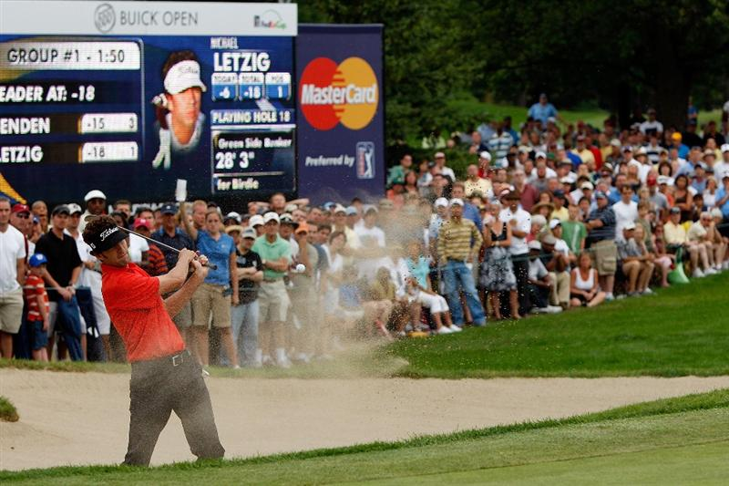 GRAND BLANC, MI - AUGUST 01:  Michael Letzig chips out of a bunker on the 18th hole during round three of the Buick Open at Warwick Hills Golf and Country Club on August 1, 2009 in Grand Blanc, Michigan.  (Photo by Chris Graythen/Getty Images)