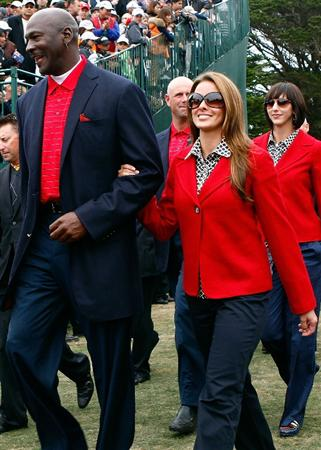 SAN FRANCISCO - OCTOBER 11:  Michael Jordan of the USA Team walks with his girlfriend Yvette Prieto to the closing cermonies during the Final Round Singles Matches of The Presidents Cup at Harding Park Golf Course on October 11, 2009 in San Francisco, California.  (Photo by Scott Halleran/Getty Images)
