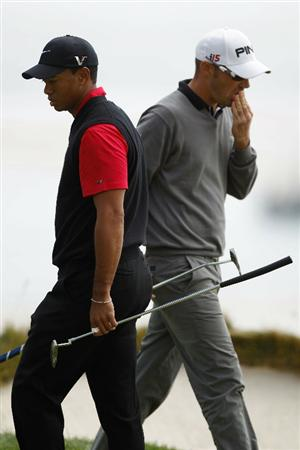 PEBBLE BEACH, CA - JUNE 20:  Tiger Woods and Gregory Havret of France walk across the sixth green during the final round of the 110th U.S. Open at Pebble Beach Golf Links on June 20, 2010 in Pebble Beach, California.  (Photo by Donald Miralle/Getty Images)