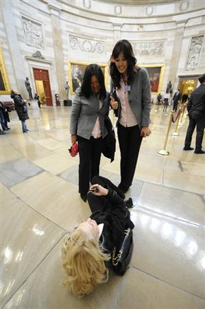 WASHINGTON - JANUARY 12:   Golfer Natalie Gulbis (C) takes photo of Christina Kim (L) and Michelle Wie of the 2009  United States Solheim Team in the Capital during visit to celebrate team win in Solheim Cup January 12, 2010 in Washington, DC.  (Photo by Mitchell Layton/Getty Images)