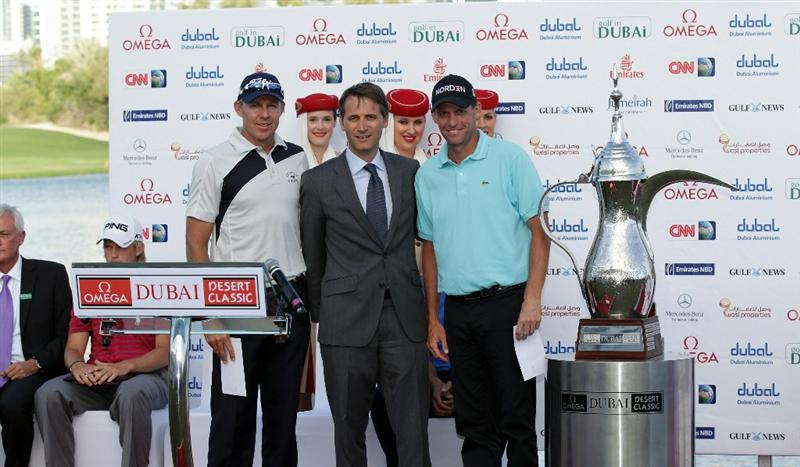 DUBAI, UNITED ARAB EMIRATES - FEBRUARY 13: James Kingston of South Africa (left) and Anders Hansen of Denmark (right) the joint second place players receive their cheques after the final round of the 2011 Omega Dubai Desert Classic on the Majilis Course at the Emirates Golf Club on February 13, 2011 in Dubai, United Arab Emirates.  (Photo by David Cannon/Getty Images)
