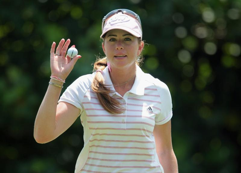 SINGAPORE - FEBRUARY 26:  Paula Creamer of the USA waves to the gallery on the 13th hole during the third round of the HSBC Women's Champions 2011 at the Tanah Merah Country Club on February 26, 2011 in Singapore, Singapore.  (Photo by Scott Halleran/Getty Images)