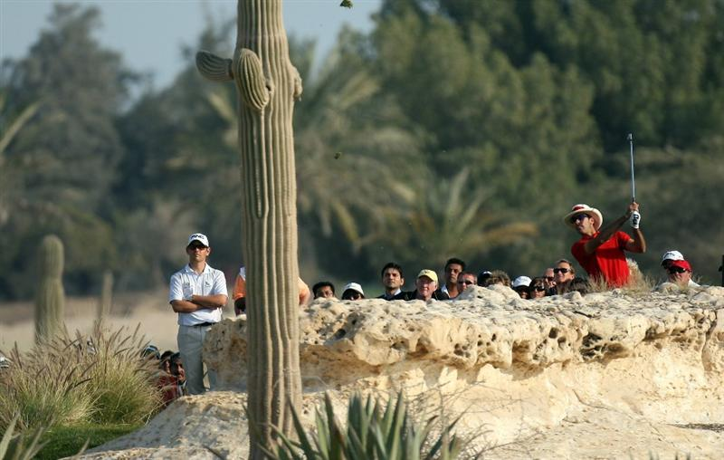 DOHA, QATAR - JANUARY 25:  Alvaro Quiros of Spain tees off on the par three 13th hole during the final round of the Commercialbank Qatar Masters at the Doha Golf Club on January 25, 2009 in Doha, Qatar.  (Photo by Ross Kinnaird/Getty Images)