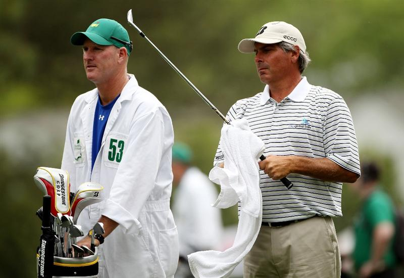 AUGUSTA, GA - APRIL 08:  Fred Couples waits with his caddie Joe Lacava on the first fairway during the first round of the 2010 Masters Tournament at Augusta National Golf Club on April 8, 2010 in Augusta, Georgia.  (Photo by Andrew Redington/Getty Images)