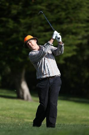 PEBBLE BEACH, CA - FEBRUARY 13:  Actor Bill Murray hits from the 14th fairway at the AT&T Pebble Beach National Pro-Am- Final Round at the Pebble Beach Golf Links on February 13, 2011 in Pebble Beach, California.  (Photo by Jed Jacobsohn/Getty Images)