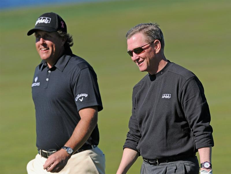PEBBLE BEACH, CA - FEBRUARY 10:  Phil Mickelson and playing partner Tim Flynn during the first round of the AT&T Pebble Beach National Pro-Am at Monterey Peninsula Country Club on February 10, 2011  in Pebble Beach, California.  (Photo by Stuart Franklin/Getty Images)