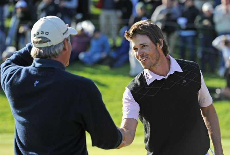 PACIFIC PALISADES, CA - FEBRUARY 20: Aaron Baddeley of Australia is congratulated by playing partner Fred Couples during the final round of the Northern Trust Open at Riviera Country Club on February 20, 2011 in Pacific Palisades, California.  (Photo by Stuart Franklin/Getty Images)