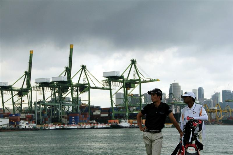 SINGAPORE - NOVEMBER 14: Liang Wen-Chong of China and his caddie waits at the 6th hole during the Final Round of the Barclays Singapore Open held at the Sentosa Golf Club on November 14, 2010 in Singapore, Singapore.  (Photo by Stanley Chou/Getty Images)