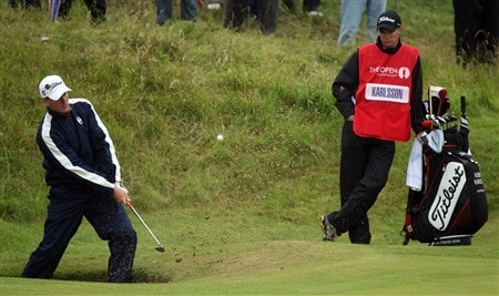 SOUTHPORT, UNITED KINGDOM - JULY 18:  Robert Karlsson of Sweden chips out of a bunker on the 1st as caddie Gareth Lord looks on during the second round of the 137th Open Championship on July 18, 2008 at Royal Birkdale Golf Club, Southport, England.  (Photo by David Cannon/Getty Images)
