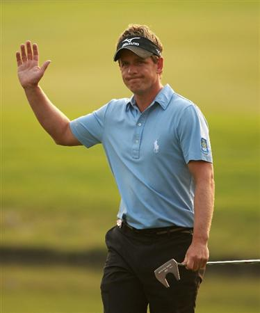 SHANGHAI, CHINA - NOVEMBER 06:  Luke Donald of England waves to the crowd on the 18th hole during the third round of the WGC-HSBC Champions at Sheshan International Golf Club on November 6, 2010 in Shanghai, China.  (Photo by Andrew Redington/Getty Images)