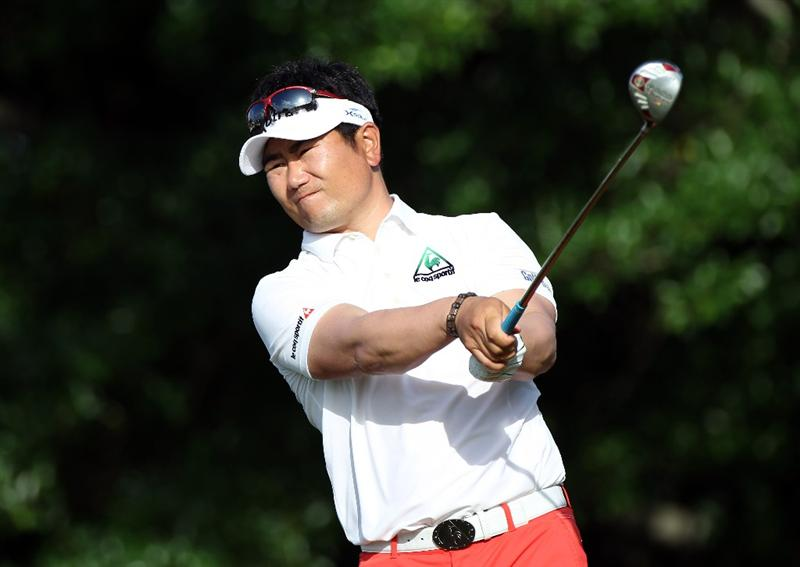 PALM BEACH GARDENS, FL - MARCH 03:  Y.E. Yang of South Korea plays a shot on the 14th hole during the first round of The Honda Classic at PGA National Resort and Spa on March 3, 2011 in Palm Beach Gardens, Florida.  (Photo by Sam Greenwood/Getty Images)