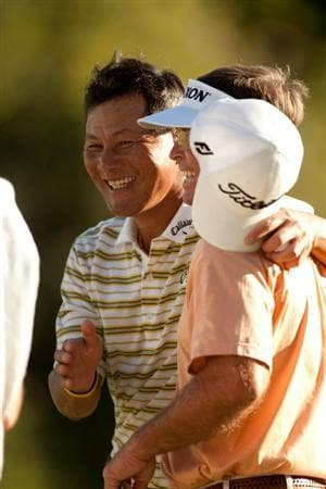 SAN ANTONIO, TX - OCTOBER 29: Chien Soon Lu of Taiwan walks off the 18th green with playing partner Sonny Skinner during the first round of the AT&T Championship at Oak Hills Country Club on October 29, 2010 in San Antonio, Texas. (Photo by Darren Carroll/Getty Images)