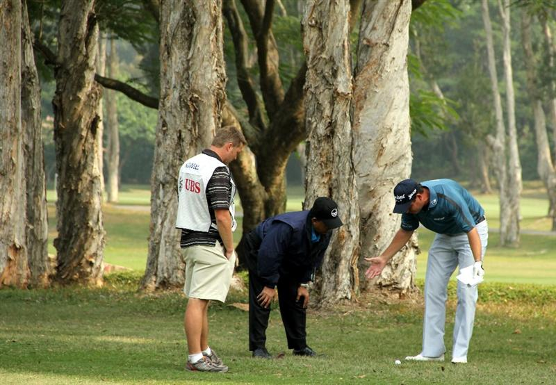 HONG KONG - NOVEMBER 19:  David Howell of England expresses an opinion with an official on the 7th hole during day two of the UBS Hong Kong Open at The Hong Kong Golf Club on November 19, 2010 in Hong Kong, Hong Kong. ( Photo by Stanley Chou/Getty Images )