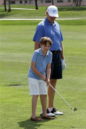 WEST PALM BEACH, FL - MARCH 21:  Ernie Els of South Africa with his son Ben who suffers from Autism enjoying time on the course during the Els for Autism Pro-am at The PGA National Golf Club on March 21, 2011 in West Palm Beach, Florida.  (Photo by David Cannon/Getty Images)