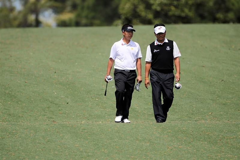 AUGUSTA, GA - APRIL 05:  Amateur Lion Kim walks with K.J. Choi of South Korea during a practice round prior to the 2011 Masters Tournament at Augusta National Golf Club on April 5, 2011 in Augusta, Georgia.  (Photo by Jamie Squire/Getty Images)