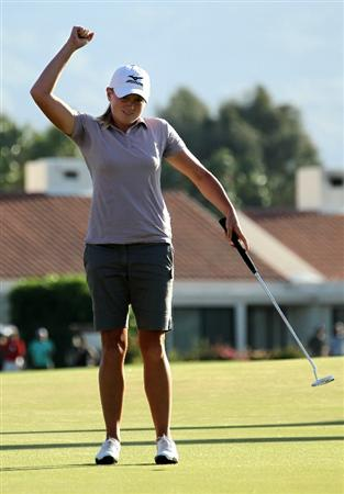 RANCHO MIRAGE, CA - APRIL 03:  Stacy Lewis celebrates after sinking the final putt and win the Kraft Nabisco Championship during the final round at Mission Hills Country Club on April 3, 2011 in Rancho Mirage, California.  (Photo by Stephen Dunn/Getty Images)