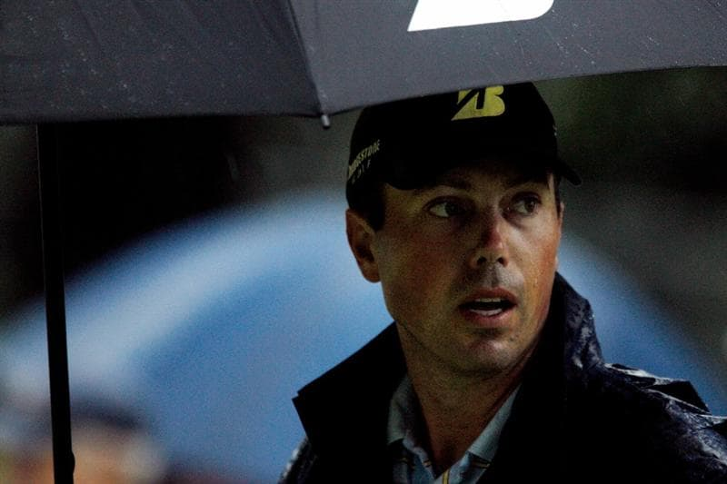 ATLANTA - SEPTEMBER 26:  Matt Kuchar waits under an umbrella after play was suspended for dangerous weather during the final round of THE TOUR Championship presented by Coca-Cola at East Lake Golf Club on September 26, 2010 in Atlanta, Georgia.  (Photo by Scott Halleran/Getty Images)