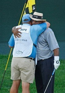 Jim Thorpe gets a hug from his caddie Tony Shepherd after winning the Charles Schwab Cup Championship at Sonoma Golf Club on October 28, 2007, in Sonoma, California. Champions Tour - 2007 Charles Schwab Cup Championship - Final RoundPhoto by Chris Condon/PGA TOUR/WireImage.com
