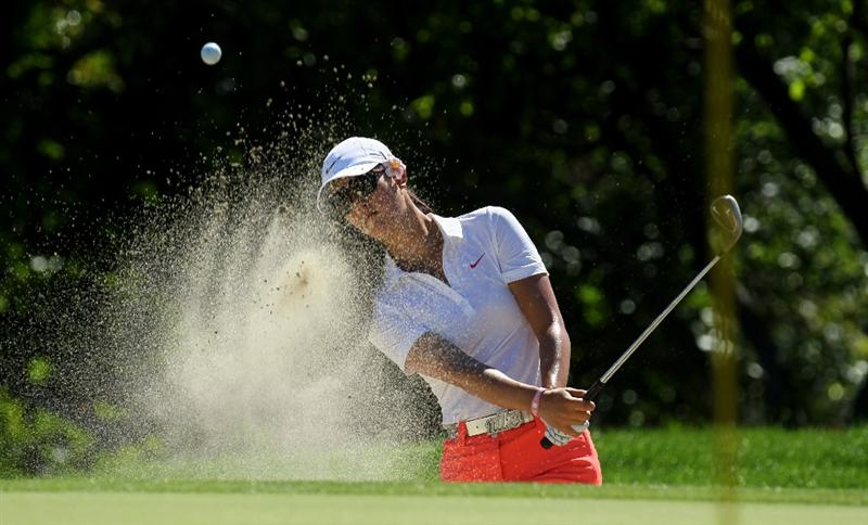 RANCHO MIRAGE, CA - MARCH 31:  Michelle Wie hits out of a bunker on the 15th hole during the first round of the Kraft Nabisco Championship at Mission Hills Country Club on March 31, 2011 in Rancho Mirage, California.  (Photo by Stephen Dunn/Getty Images)