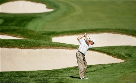 BLOOMFIELD HILLS, MI - AUGUST 06:  Fred Couples plays a shot from a fairway during a practice round prior to the 90th PGA Championship at Oakland Hills Country Club on August 6, 2008 in Bloomfield Township, Michigan.  (Photo by Hunter Martin/Getty Images)