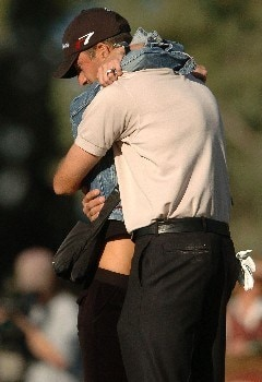 Geoff Ogilvy is greeted by his wife after defeating Kevin Na in a two hole playoff in the final round of the PGA's Tour 2005 Chrysler Classic of Tucson at the Omni Tucson National Golf Resort & Spa February 27, 2005 in Tuscon, Arizona.