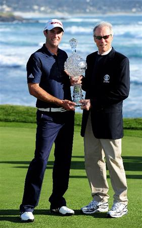 PEBBLE BEACH, CA - FEBRUARY 14:  Dustin Johnson is presented with the trophy by actor Clint Eastwood after winning the AT&T Pebble Beach National Pro-Am at Pebble Beach Golf Links on February 14, 2010 in Pebble Beach, California.  (Photo by Stuart Franklin/Getty Images)