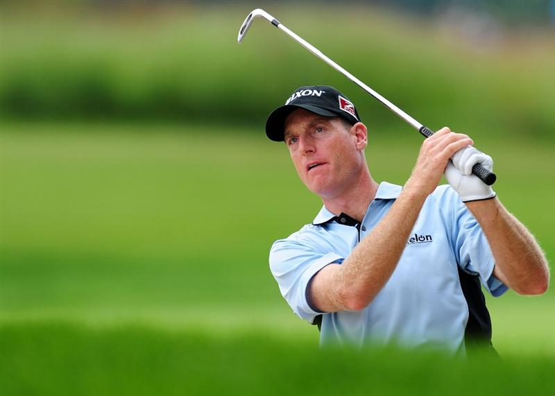 CHASKA, MN - AUGUST 13:  Jim Furyk his a shot on the second hole during the first round of the 91st PGA Championship at Hazeltine National Golf Club on August 13, 2009 in Chaska, Minnesota.  (Photo by Stuart Franklin/Getty Images)