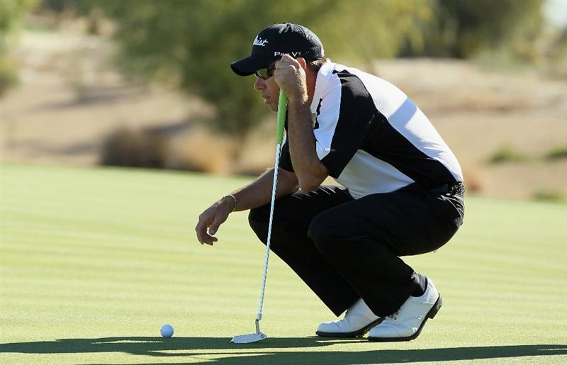LA QUINTA, CA - JANUARY 21:  Brian Davis of England lines up a putt on the third green during the third round of the Bob Hope Classic at the Silver Rock Resort on January 21, 2011 in La Quinta, California.  (Photo by Jeff Gross/Getty Images)