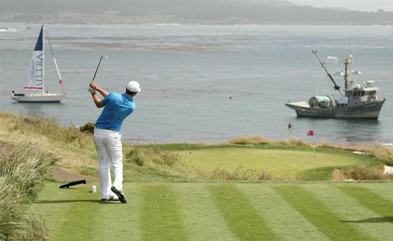 PEBBLE BEACH, CA - JUNE 20:  Dustin Johnson hits his tee shot on the seventh hole during the final round of the 110th U.S. Open at Pebble Beach Golf Links on June 20, 2010 in Pebble Beach, California.  (Photo by Ross Kinnaird/Getty Images)