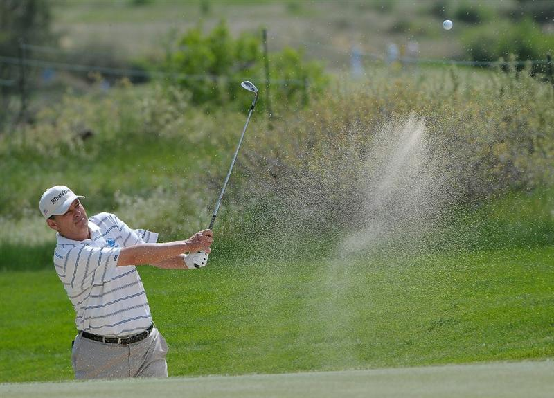 PARKER, CO - MAY 28: Loren Roberts hits out of the fairway bunker on the 8th hole during the second round of the Senior PGA Championship at the Colorado Golf Club on May 28, 2010 in Parker, Colorado.  (Photo by Marc Feldman/Getty Images)