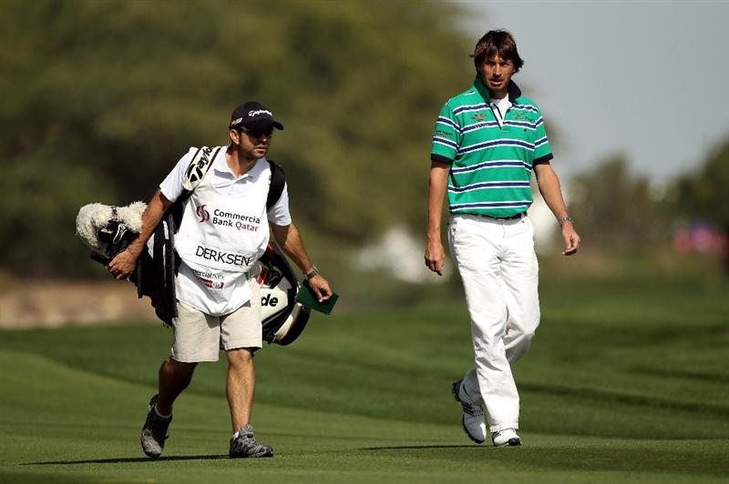 DOHA, QATAR - JANUARY 28:  Robert Jan Derksen of The Netherlands walks with his caddie on the 18th hole during the first round of the Commercialbank Qatar Masters at Doha Golf Club on January 28, 2010 in Doha, Qatar.  (Photo by Andrew Redington/Getty Images)