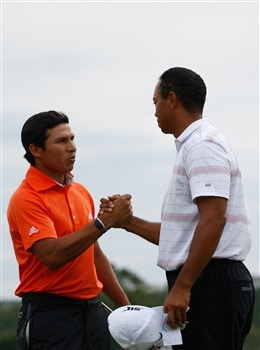 AUGUSTA, GA - APRIL 12:  Tiger Woods shakes hands with Andres Romero of Argentina during the third round of the 2008 Masters Tournament at Augusta National Golf Club on April 12, 2008 in Augusta, Georgia.  (Photo by Jamie Squire/Getty Images)