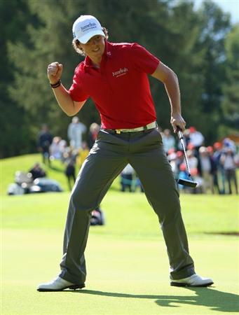 CRANS, SWITZERLAND - SEPTEMBER 07:  Rory McIlroy of Northern Ireland celebrates holing a birdie putt on the 15th hole during the final round of the Omega European Masters at Crans-Sur-Sierre Golf Club on September 7, 2008 in Crans Montana, Switzerland.  (Photo by Andrew Redington/Getty Images)