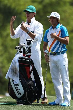 AUGUSTA, GA - APRIL 08:  Rickie Fowler chats with his caddie Joe Skovron on the first hole during the second round of the 2011 Masters Tournament at Augusta National Golf Club on April 8, 2011 in Augusta, Georgia.  (Photo by Andrew Redington/Getty Images)