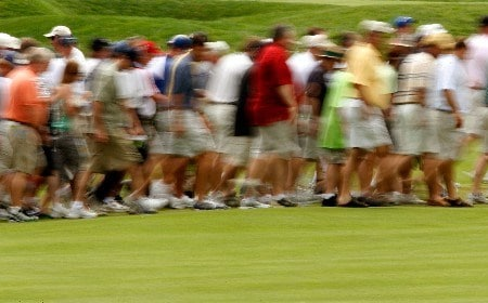 OAKMONT, PA - JUNE 14:  Golf fans walk across a fairway during the first round of 107th U.S. Open Championship at Oakmont Country Club on June 14, 2007 in Oakmont, Pennsylvania.  (Photo by Jim Rogash/Getty Images)