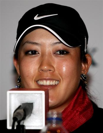 SINGAPORE - FEBRUARY 23:  Michelle Wie of the USA talks to the media during a photocall at Raffles Hotel prior to the HSBC Women's Champions at the Tanah Merah Country Club  on February 23, 2010 in Singapore.  (Photo by Andrew Redington/Getty Images)