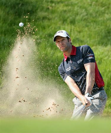 NEWPORT, WALES - JUNE 03:  Bradley Dredge of Wales plays a bunker shot on the 17th hole during the first round of the Celtic Manor Wales Open on The Twenty Ten Course at The Celtic Manor Resort on June 3, 2010 in Newport, Wales.  (Photo by Andrew Redington/Getty Images)