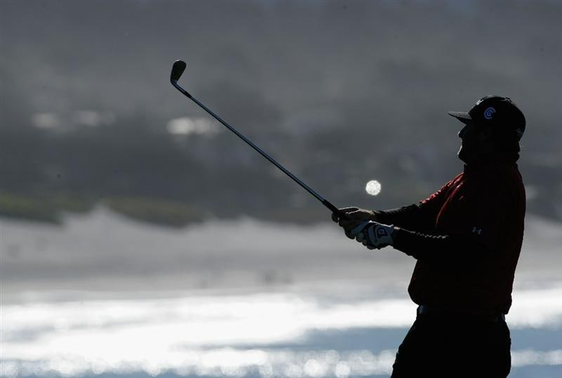 PEBBLE BEACH, CA - FEBRUARY 11:  Steve Marino plays his approach shot on the eighth hole during the second round of the AT&T Pebble Beach National Pro-Am at the Pebble Beach Golf Links on February 11, 2011  in Pebble Beach, California  (Photo by Stuart Franklin/Getty Images)