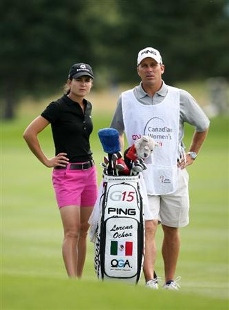 CALGARY, AB - SEPTEMBER 03: Lorena Ochoa of Mexico discusses her second shot on the 18th hole with her caddie Greg Johnston during the first round of the Canadian Women's Open at Priddis Greens Golf & Country Club on September 3, 2009 in Calgary, Alberta, Canada. (Photo by Hunter Martin/Getty Images)