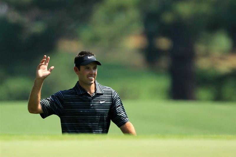 AUGUSTA, GA - APRIL 10:  Charl Schwartzel of South Africa waves to the gallery after holing a shot for eagle on the third green during the final round of the 2011 Masters Tournament on April 10, 2011 in Augusta, Georgia.  (Photo by David Cannon/Getty Images)