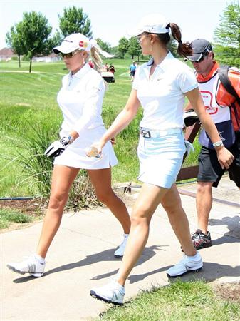 SPRINGFIELD, IL - JUNE 04:  Natalie Gulbis talks with Michelle Wie as they walk up to the 16th hole during the first round of the LPGA State Farm Classic golf tournament at Panther Creek Country Club on June 4, 2009 in Springfield, Illinois.  (Photo by Christian Petersen/Getty Images)