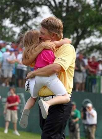 FORT WORTH, TX - MAY 22: David Toms hugs his daughter Anna on the 18th green after winning the Crowne Plaza Invitational at Colonial Country Club on May 22, 2011 in Fort Worth, Texas. (Photo by Hunter Martin/Getty Images)