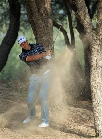 DUBAI, UNITED ARAB EMIRATES - FEBRUARY 10:  Henrik Stenson of Sweden in action during the first round of the Omega Dubai Desert Classic on the Majlis course at the Emirates Golf Club on February 10, 2011 in Dubai, United Arab Emirates.  (Photo by Andrew Redington/Getty Images)