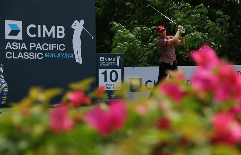 KUALA LUMPUR, MALAYSIA - OCTOBER 31: Ricky Barnes of England hits his tee shot on the 10th hole during day four of the CIMB Asia Pacific Classic at The MINES Resort & Golf Club on October 31, 2010 in Kuala Lumpur, Malaysia. (Photo by Stanley Chou/Getty Images)