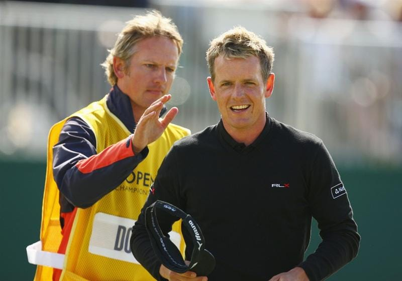 TURNBERRY, SCOTLAND - JULY 19:  Luke Donald of England is congratulated by his caddy Christian Donald on the 18th green during the final round of the 138th Open Championship on the Ailsa Course, Turnberry Golf Club on July 19, 2009 in Turnberry, Scotland.  (Photo by Richard Heathcote/Getty Images)